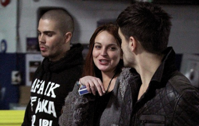 Lindsay Lohan backstage with Max George and Tom Parker at the Boston Jingle Ball gig on Thursday night