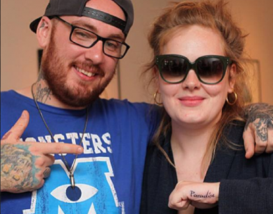 Adele showing off new tattoo with Bang Bang posted on Facebook